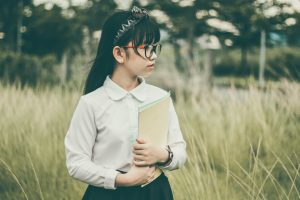 young girl wearing reading glasses