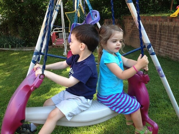 kids on a swing at daycare