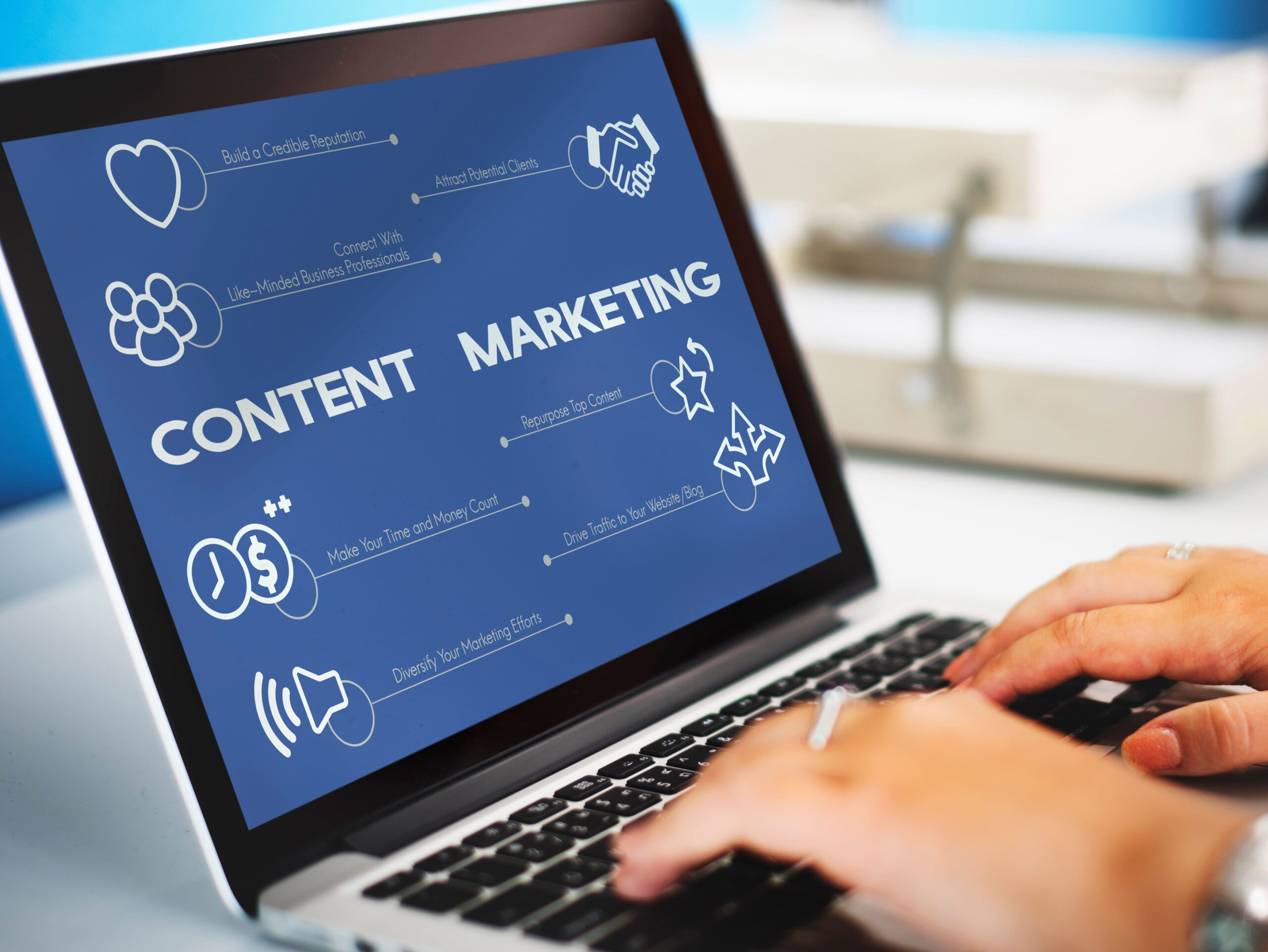 Person using a laptop with content marketing concept - child care