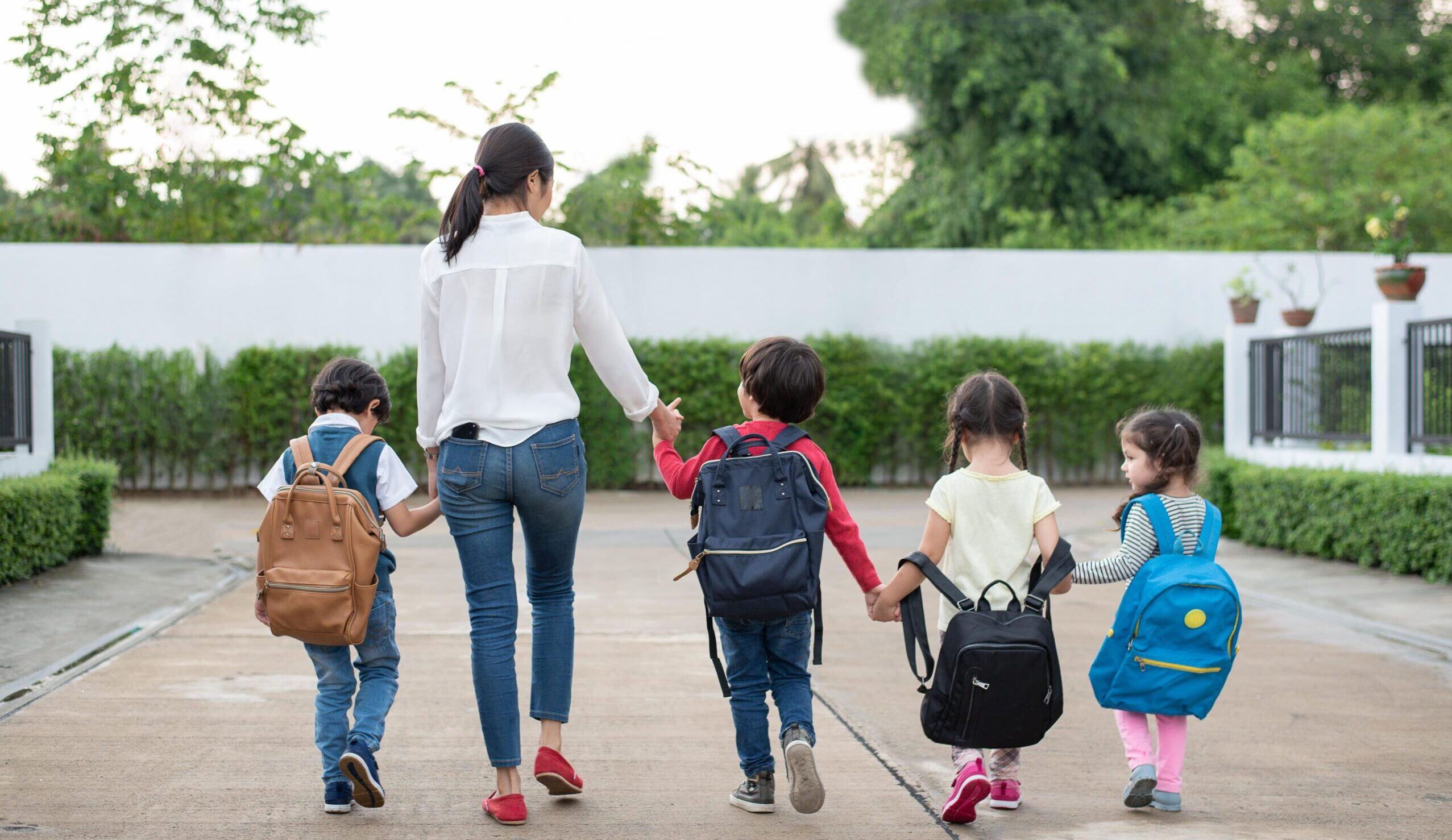 woman and children walking - Parents Switch Child Care