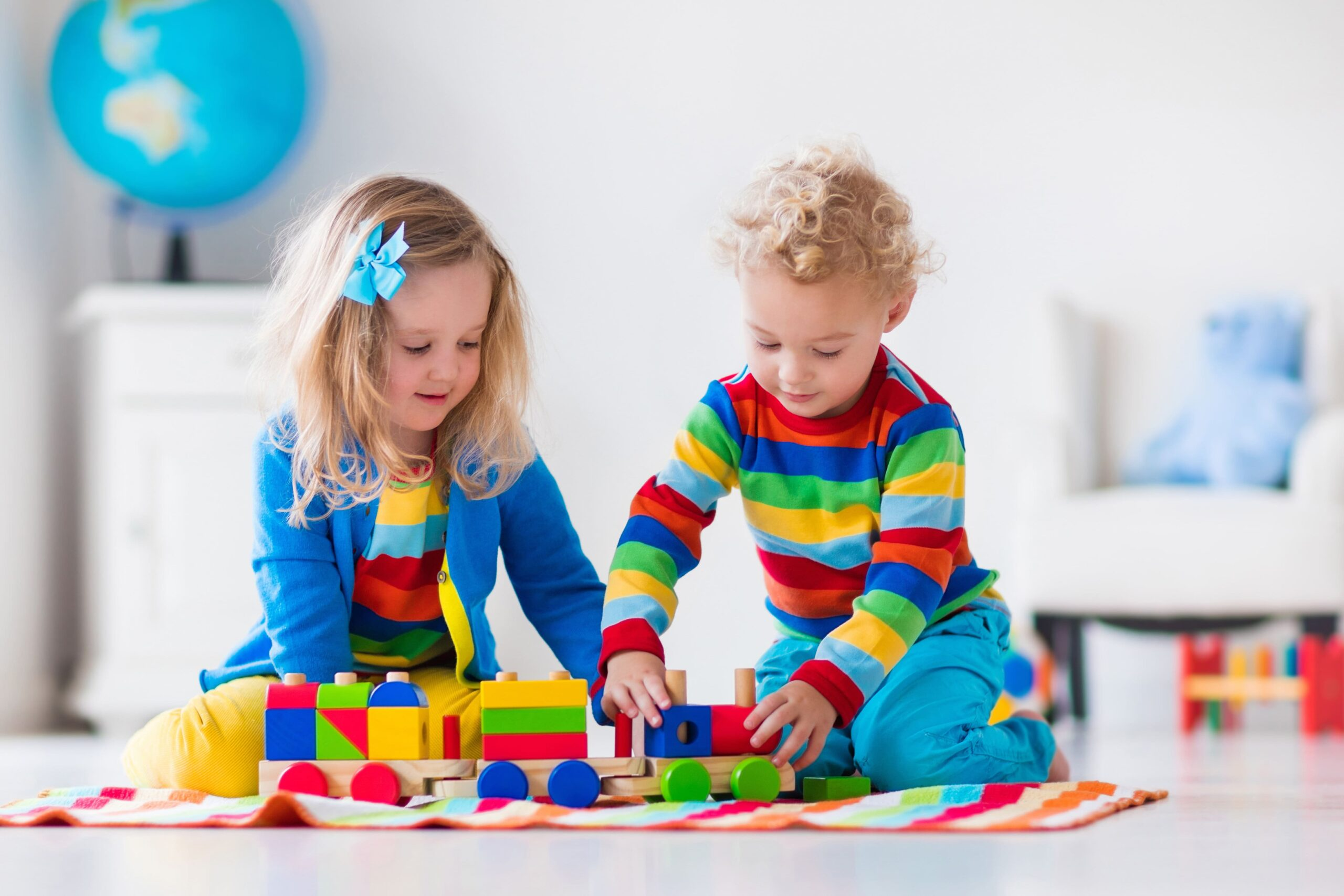Children playing with wooden train. |Daycare Requirements to Start Your Own Center